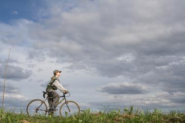 Woman at bicycle