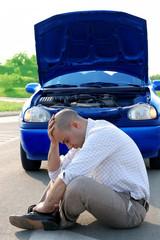 businessman beside defected a car