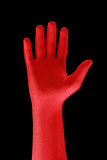 strange hand with a red glove poster