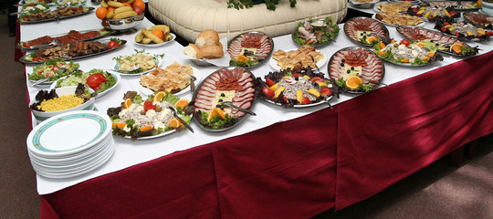 hotel table full of tasty food