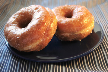 two glazed doughnuts