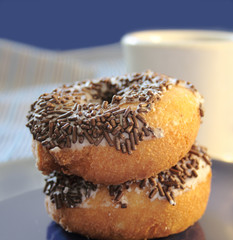two doughnuts with chocolate sprinkles