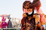 a woman in costume at the venice carnival poster