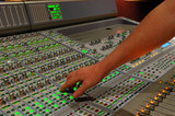 hand on audio mixing console poster