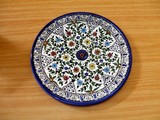 decorative dish/ plate of pottery. art in israel. poster