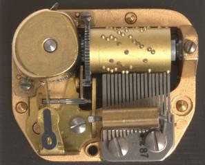 Musical box inside mechanism close up