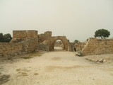 Archway entrace to a historical place in Caesarea in Israel poster