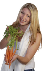 smiling woman offering carrots