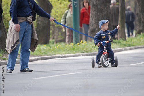 baby on bike in park