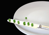 peas on a knife