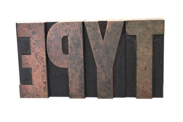 wood letters spell out the word 'type'