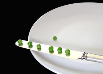 peas on a knife
