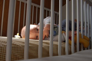 closeup of baby boy in crib