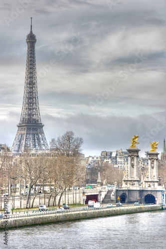 eiffel tower and columns of alexander iii bridge