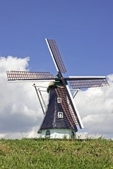dutch windmill against a blue sky