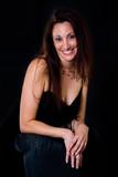 hispanic woman in her 30s in black dress poster