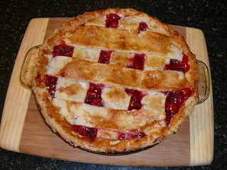 cherry pie on cutting board