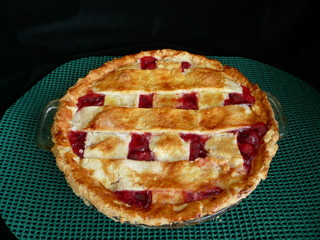cherry pie on green