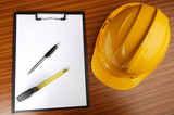 yellow helmet and notepad poster
