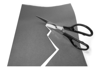 scissors cutting a paper