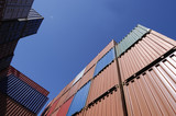 freight containers against blue sky poster