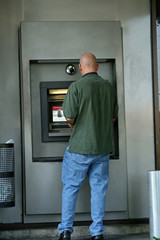 man at atm machine