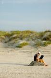 telecommuter on a beach working 2 - 3335170