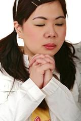 asian girl solemnly praying