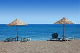 black beach umbrellas - greece poster