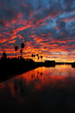 dramatic red sunset reflected  over california poster