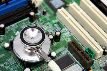a stethoscope on a computer circuit board