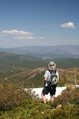 hiker above mountains