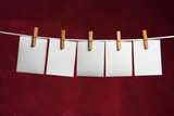 five white slip of paper attach to rope clothes peg poster