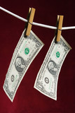 two american dollar attach to rope clothes peg poster