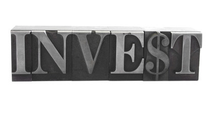 the word 'invest' in old letterpress metal type