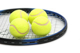 tennis balls on the racket - isolated on white