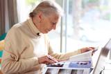 elderly lady reading magazine poster