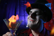 magician with flaming martini glass