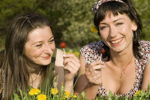 smiling women with lollipop