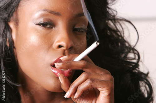 sexy black woman smoking a cigarette