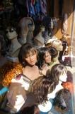 wigs in window