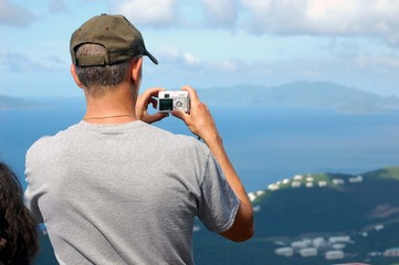 tourist taking digital photos