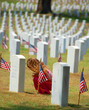 child praying in cemetery