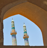 two minarets in an ancient city of yazd, iran poster