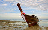 longtail boat in low tide, thailand poster