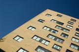 apartment building blue sky poster
