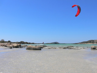 kitesurfing round the rocks