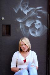 sitting by graffiti