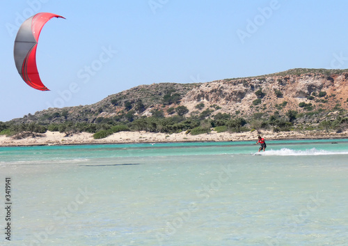 kitesurfer with a red kite