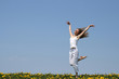 smiling girl dancing in dandelion field